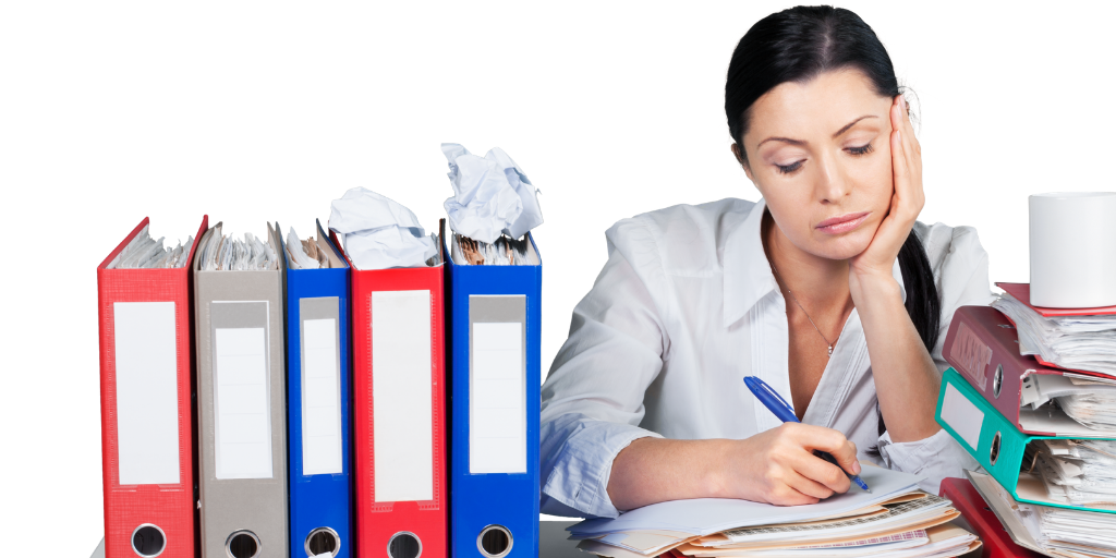 A woman surrounded by paperwork
