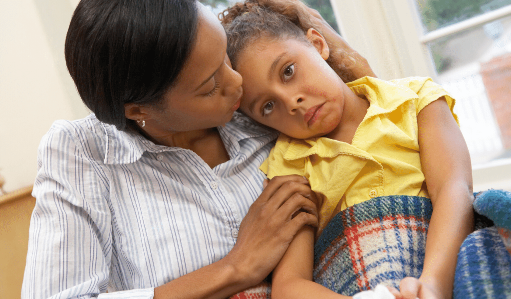 childminder with a sick child