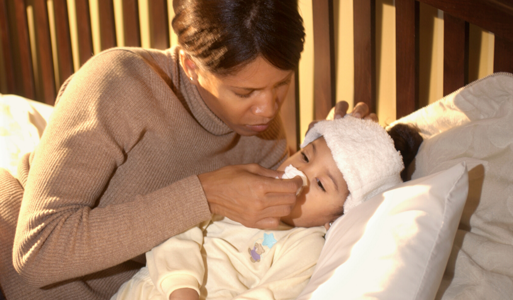 woman with sick child
