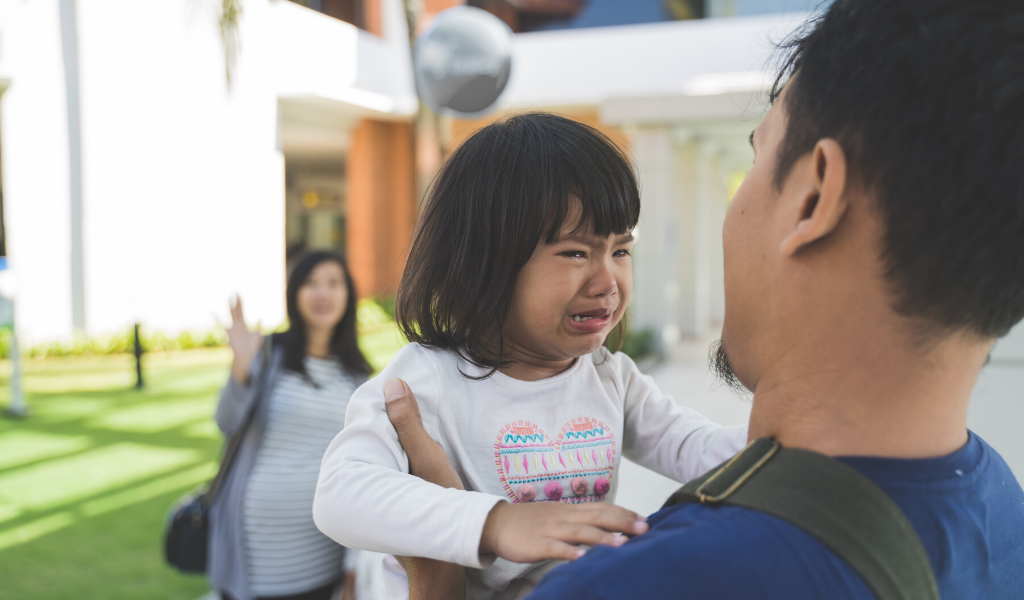 child crying as she's separated from dad