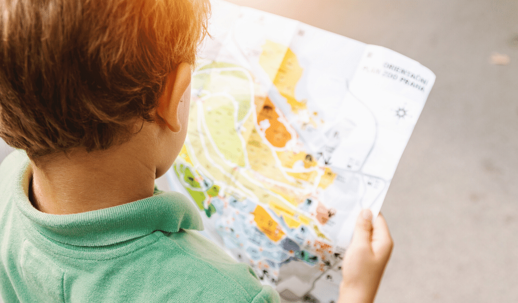 child reading a map