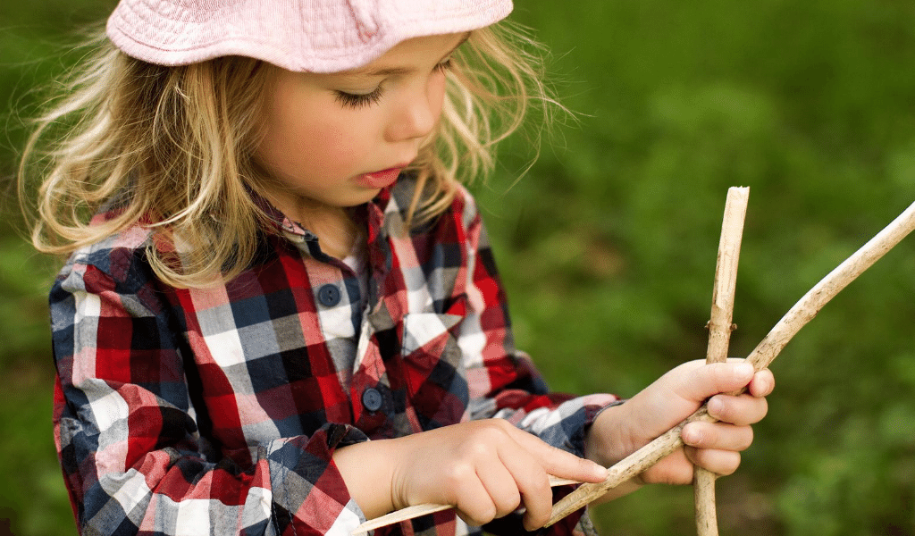 girl playing with sticks