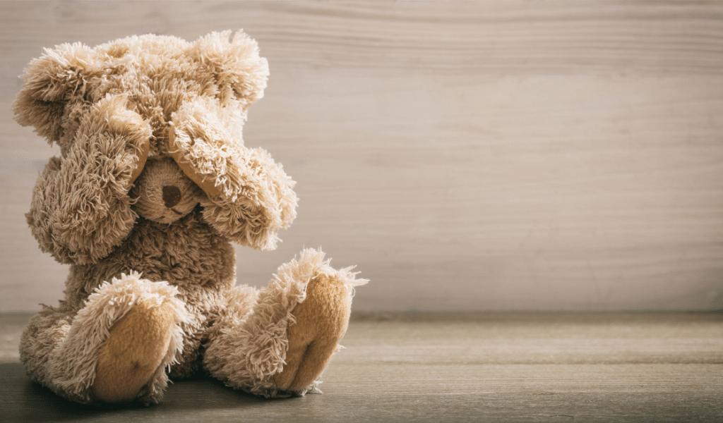 teddy bear covering their eyes