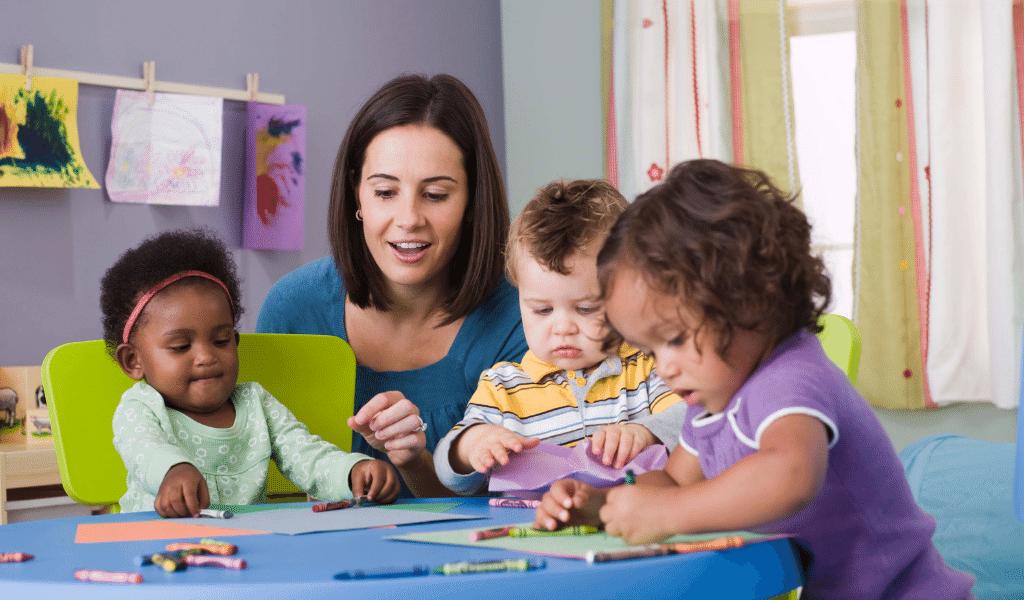 Childminder with diverse children