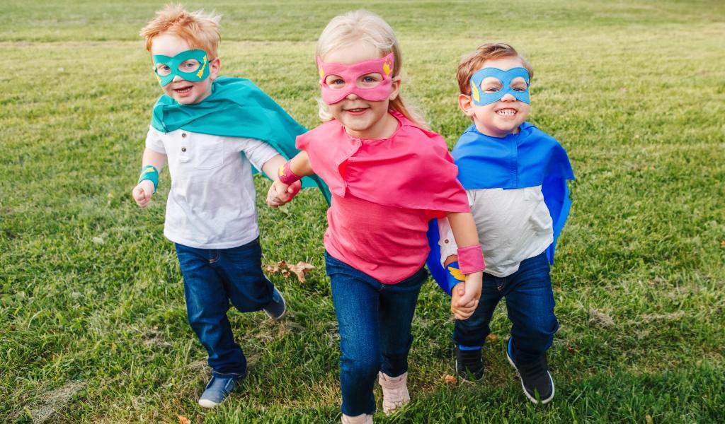 children dressed as superheroes