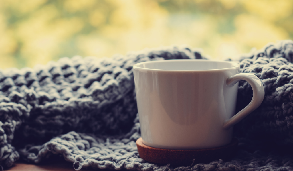 cup of coffee and cosy blanket