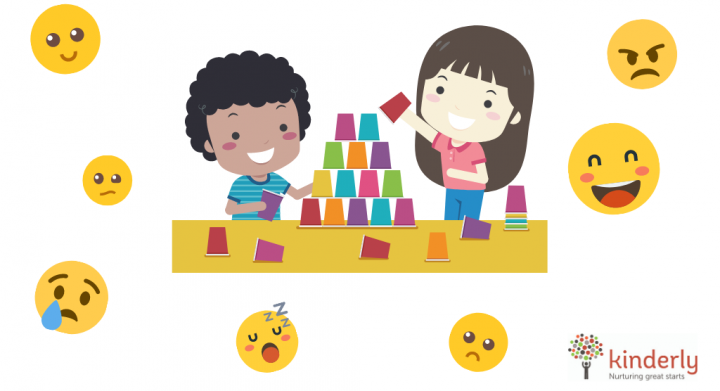 children happy playing surrounded by emojis os emotions