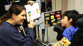 Practitioner using symbols to support non-verbal child