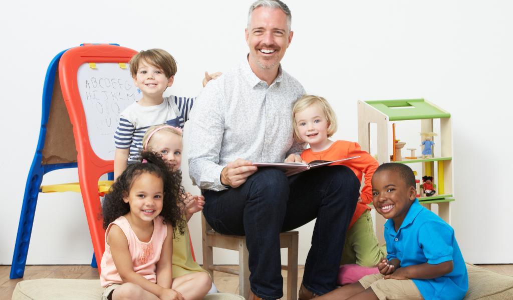 male childminder with children
