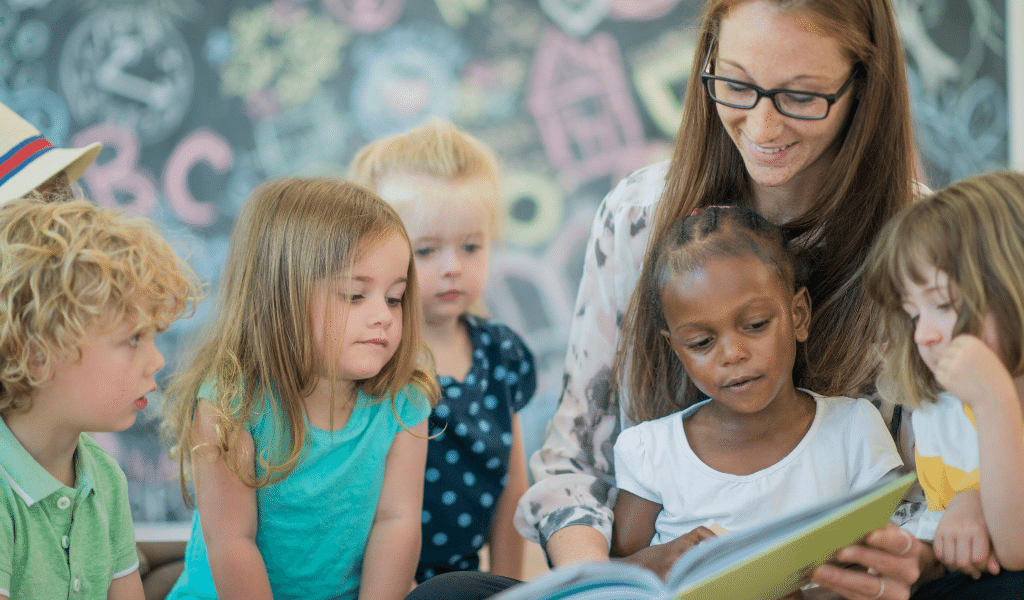childminder with kids reading