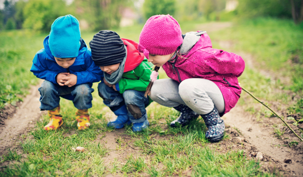 children discovering in nature